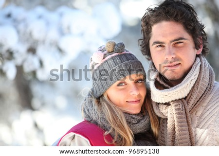 Couple walking outside on a winter's day - stock photo
