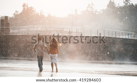 couple walking under summer rain