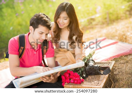 Couple watching tourists travel map to visit. - stock photo