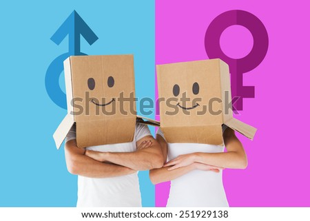 Couple wearing smiley face boxes on their heads against female gender symbol - stock photo