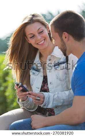 Couple weds at messages in your mobile phone - stock photo