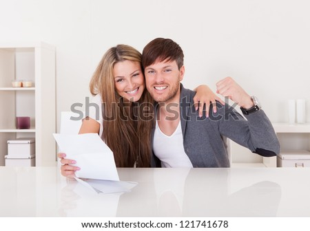 Couple were happy when good news received in writing. - stock photo