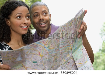 Couple with a map - stock photo