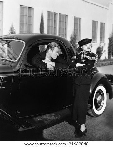 Couple with antique car - stock photo