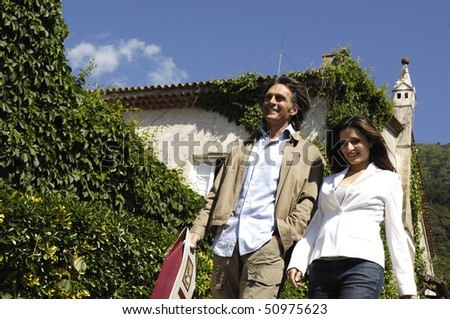 Couple with bags in the country - stock photo
