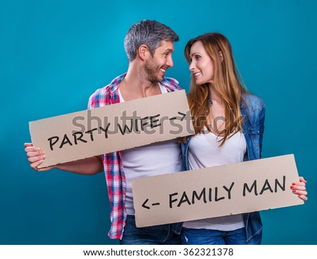 couple with banner with different ideas and wishes description - stock photo