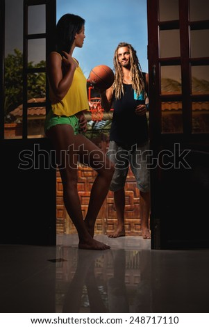 Couple with basket ball at home - stock photo