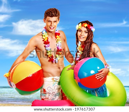 Couple with beach accessories at Hawaii . Summer outdoor.