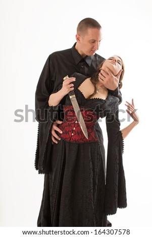 Couple with Dagger - stock photo