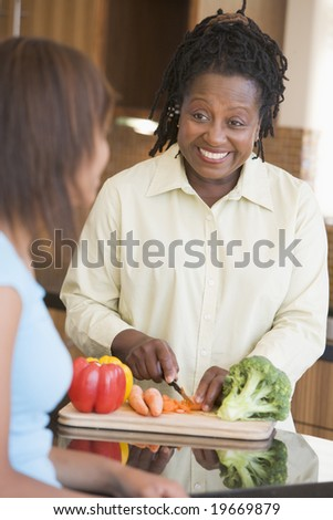 Couple With Daughter Preparing meal,mealtime