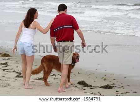 couple with dog at beach