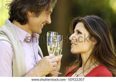 Couple with glass of wine - stock photo