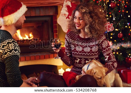 Couple with glasses of wine celebrating Christmas