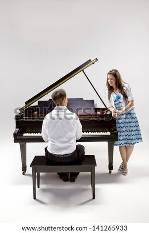 Couple with Grand piano 2 in white shirt, black pants and sundress with red rose.
