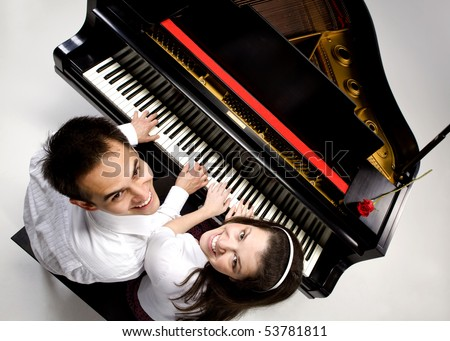 Couple with Grand piano 6 sitting at piano bench with red rose.