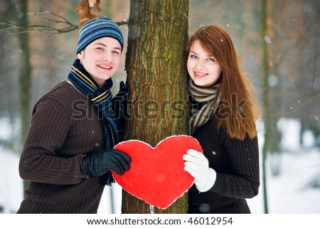 Couple with heart smiling - stock photo