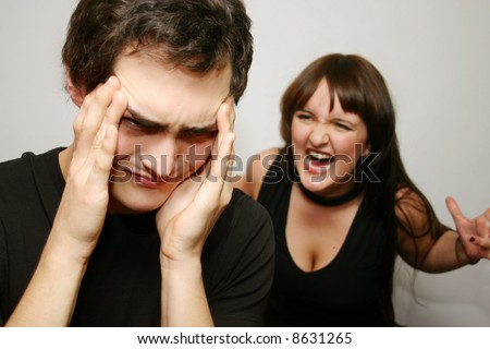 couple with issues - woman complaining about her boyfriend so energetic that he already suffers from a headache - stock photo