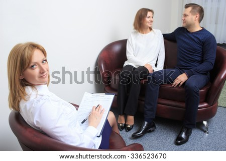 couple with problem on reception for family psychologist - stock photo