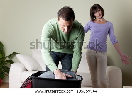 Couple with problems, man going away - stock photo