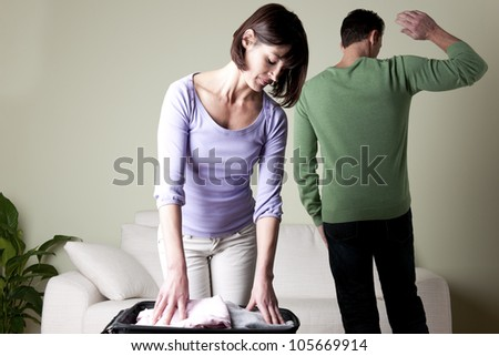 Couple with problems, man going away, woman going away - stock photo