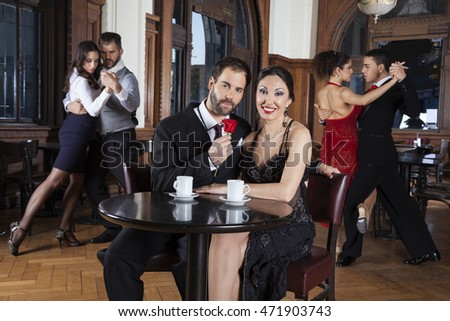 Couple With Rose Smiling While Enjoying Tango Performance