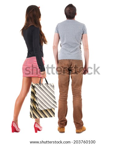 couple with shopping bag. rear view. Isolated over white. - stock photo
