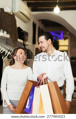 Couple with shopping bags at fashion boutique