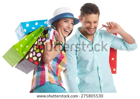 Couple with shopping bags. Studio - stock photo