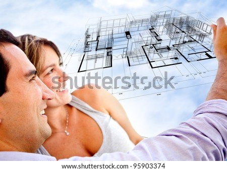 Couple with the blueprints of their dream house - stock photo