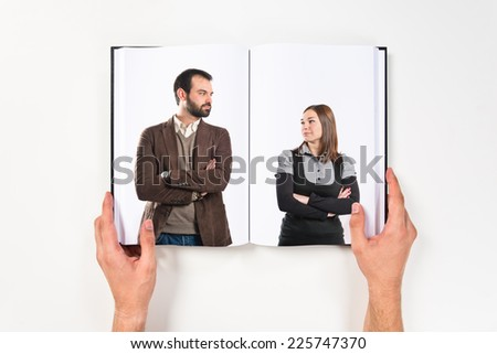 Couple with their arms crossed  printed on book