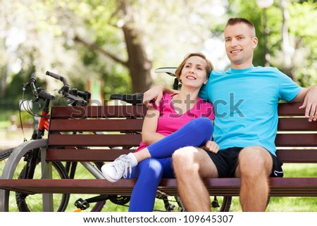 Couple with their bikes in a park