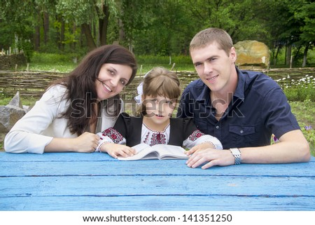 Couple with their daughter - stock photo