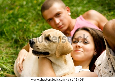 Couple With Their Puppy