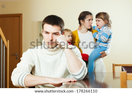 Couple with two small children in quarrel - stock photo