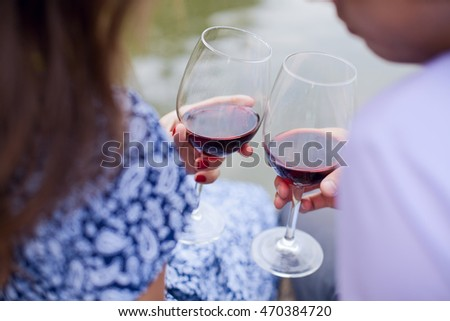 couple with wineglasses on a beach