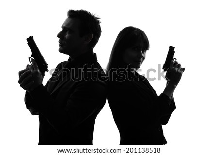 couple woman man detective secret agent criminal with gun in silhouette studio isolated on white background - stock photo