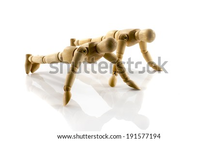couple wooden puppets workout isolated on white - stock photo