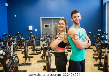 Couple working out together at the gym - stock photo