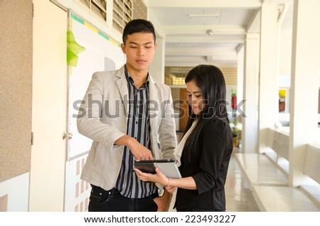 couple young Asian business use Tablet for presentation