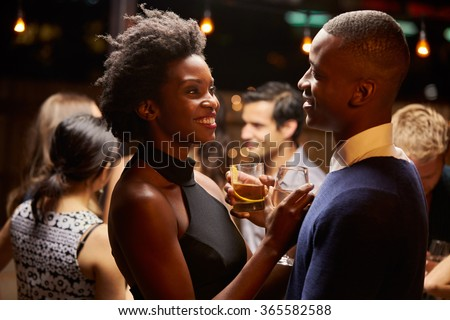 Couples Dancing And Drinking At Evening Party - stock photo
