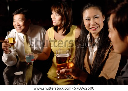 Couples drinking at bar