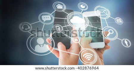 Couples hands holding smartphones against technology interface
