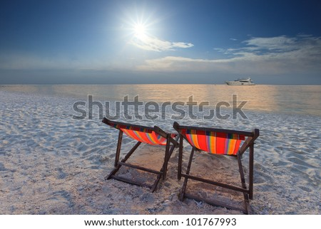 couples of chairs beach at sea side and sun shining in the sky