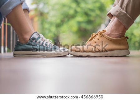 couples shoes sitting next to each other - stock photo