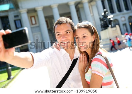 Couplle taking picture in front of Prado Museum, Madrid - stock photo