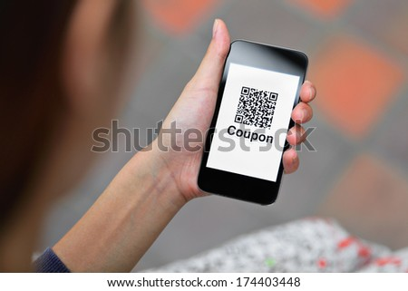 Coupon QR code on smart phone  - stock photo