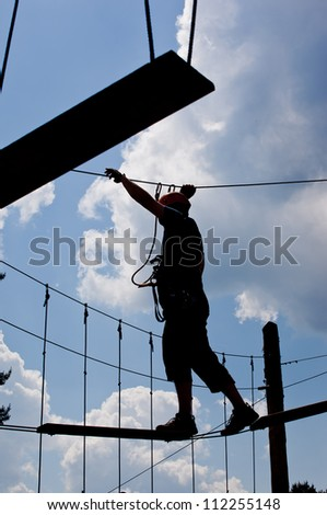 Courageous boy taking  step on a survival tour - stock photo