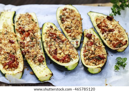 Courgettes stuffed with breadcrumbs, pine nuts, sun dried tomatoes and thyme