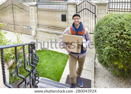 Courier Delivering a Package up on the stairs - stock photo