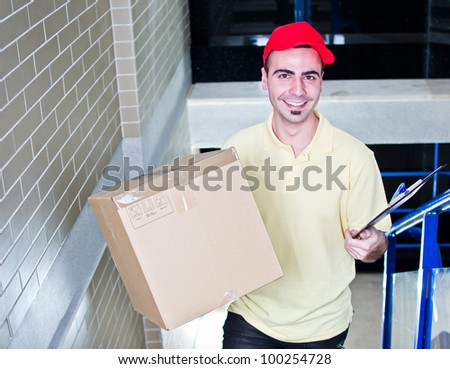 Courier during delivering packages - stock photo